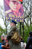Man hold flag with portrait of Joseph Stalin, Soviet Union leader, during ceremonial parade at Alley of Glory dedicated to 69th Anniversary of victory in Second World War 1941-1945 in Odessa,Ukraine — Stock Photo