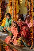 Ыenior women perform puja - ritual ceremony at holy Pushkar Sarovar lake,India — Stock Photo