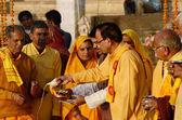 Senior men perform ritual ceremony at holy Pushkar Sarovar lake,Pushkar,India — Stock Photo