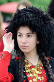 Young woman dancing in traditional Georgian  costume at Day of Kiev holiday — Stock Photo