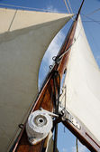 Boat standing and running rigging - mainsail,backstay,pulley blocks,winch,rope and guy lines — Stock Photo