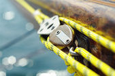 Closeup of mainsheet on old vintage wooden yact with yellow rope, line used to control the angle of the mainsail to the wind — Stock Photo