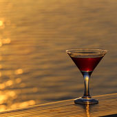 Glass of red wine at sea — Stock Photo