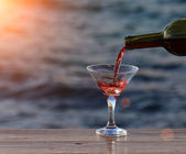 Glass of wine at sea — Stock Photo