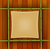 Bamboo frame with parchment banner on the wooden background — Stock Vector