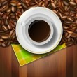 Cup of coffee, beans and napkin on wooden background — Stock Vector