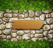 Stone wall with wooden arrow and leaves — Stock Vector