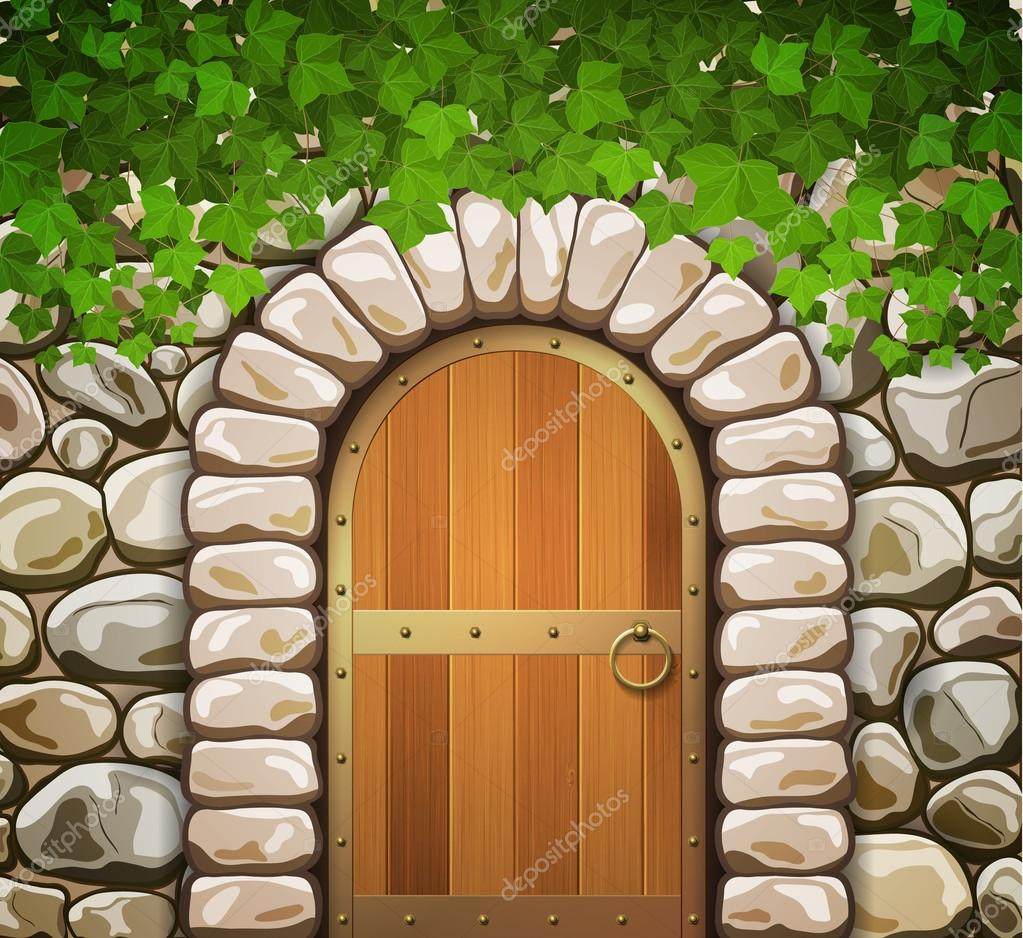 Muro de piedra con forma de arco medieval puerta de madera for Puertas en forma de arco