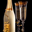 Glasses of champagne with bottle — Stock Photo #29895053