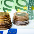 Euro banknotes with various coins — Stock Photo