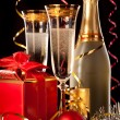 Glasses of champagne with bottles and christmas balls — Stock Photo #29895149