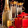Champagne with christmas balls and the gift — Stock Photo