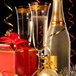 Glasses of champagne with bottles and christmas balls — Stock Photo #29895259
