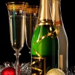 Stock Photo: Glasses of champagne with bottles and christmas balls