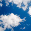 Stock Photo: Blue sky and beautiful white clouds