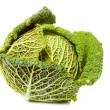 Ripe savoy cabbage covered with dew drops — Stock Photo