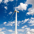 Wind turbine on blue sky — Foto de Stock