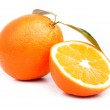 Orange and sliced orange with leaves on white background — Stock Photo