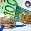Euro banknotes with various coins — Stockfoto
