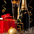 Glasses of champagne with bottles and christmas balls — Stock Photo #29895697