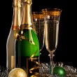 Glasses of champagne with bottles and christmas balls — Stock Photo #29895699
