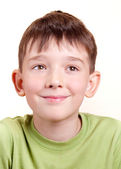 A portrait of a cute smiling little boy, isolated on a white background. — Stock Photo
