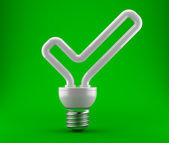 Bulb in the form of a ok check mark — Stock Photo