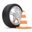 Car alloy wheel with road cone - ストック写真