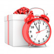 Alarm clock and gift box — Stock Photo