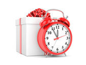 Alarm clock and gift box — Stock Photo