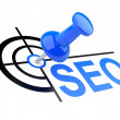 Stock Photo: Push pin with SEO target