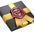 Black box with sealing wax and gold ribbon — Stock Photo