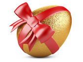 Golden easter egg with red ribbon — Stock Photo