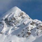 Snow covered mountain peak — Stock Photo #2299372