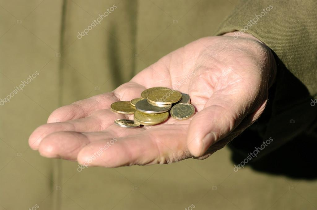 Hands of a beggar with coins — Stock Photo #13733722