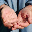 Stock Photo: Hands of beggar