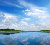 River and blue sky — Stock Photo
