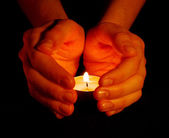 Candle in a hand — Stock Photo