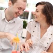 Young couple eating pizza in cafe — Stock Photo