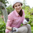 Young woman with hoe working in the garden bed — Stock Photo #13363874
