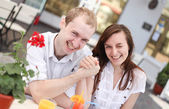 Happy young couple in cafe — Stock Photo