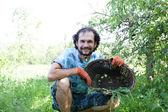 Man holding green onions — Stock Photo