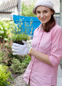 Woman with flowers in pot — Stock Photo