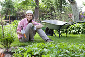 Portrait of woman in the garden — Stock Photo