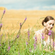 Stock Photo: Portrait of the young beautiful smiling woman outdoors