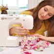 Stock Photo: Womseamstress work on sewing-machine