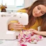 Woman seamstress work on the sewing-machine — Stock Photo