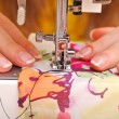 Hand sewing on a machine — Stock Photo #13733090