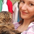 Girl with a cat — Stock Photo #13734114