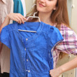 Happy young woman shopping for clothes at the mall — Stock Photo #13734153